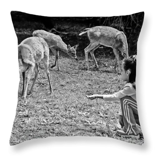 Children Throw Pillow featuring the photograph Gaining Trust by Bob and Nadine Johnston