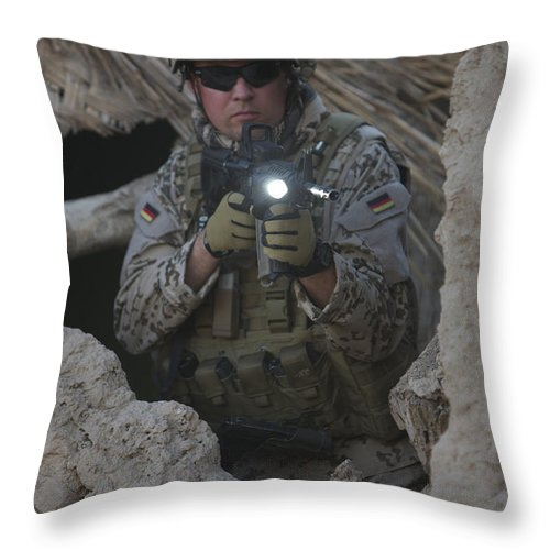 Operation Enduring Freedom Throw Pillow featuring the photograph German Army Soldier Armed With A M4 by Terry Moore