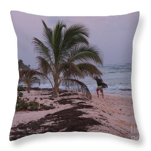 Surfer Throw Pillow featuring the photograph Grand Cayman Surfer by John Malone