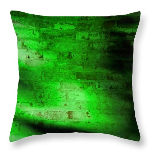 A Grungy Brick Wall With Green Lighting And Shadows. Throw Pillow featuring the photograph Green Brick Wall by Susan Leggett