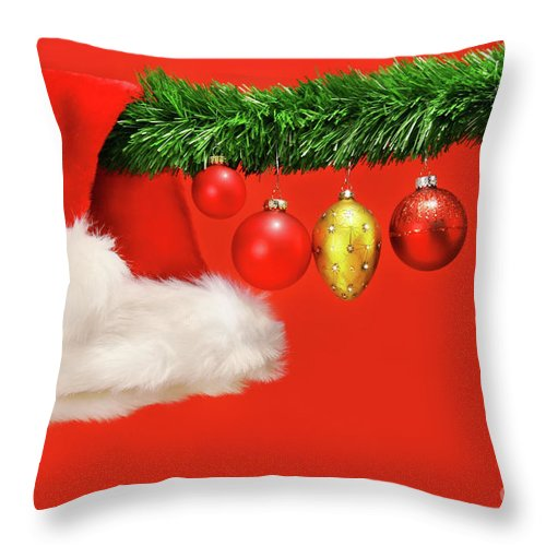 Background Throw Pillow featuring the photograph Green Garland With Santa Hat And Ornaments by Sandra Cunningham