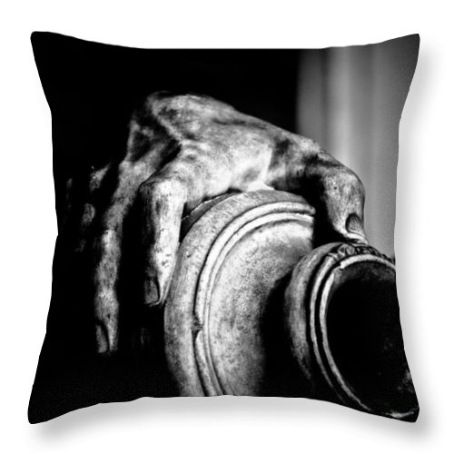 Black Throw Pillow featuring the photograph Hand And Vessel by Hakon Soreide