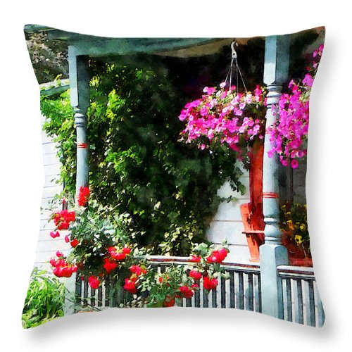 Hanging Baskets Throw Pillow featuring the photograph Hanging Baskets And Climbing Roses by Susan Savad