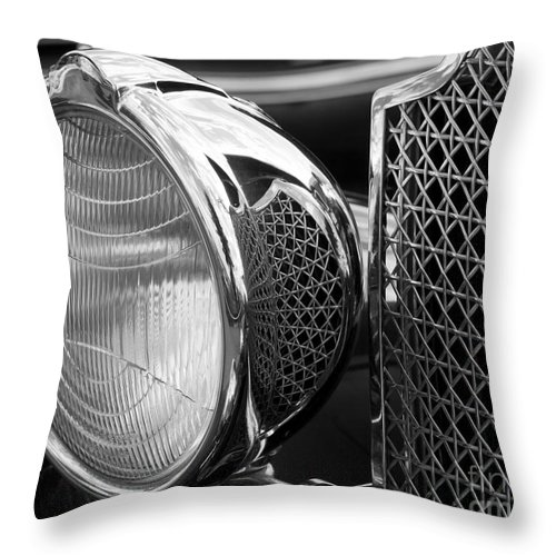 Reflection Throw Pillow featuring the photograph Headlamp by Chris Dutton