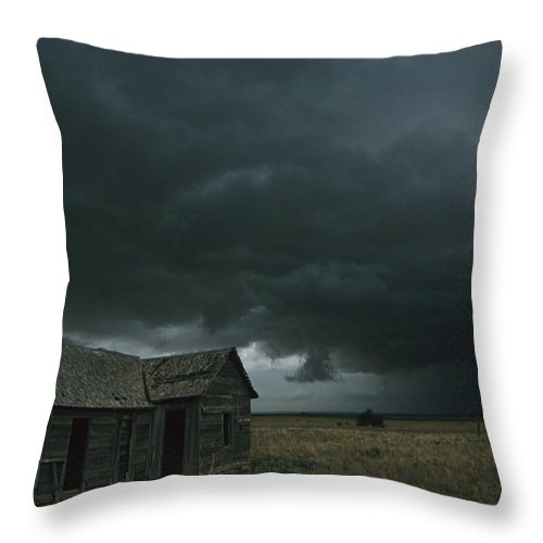 Outdoors Throw Pillow featuring the photograph Heavy Dark Clouds Foretell A Possible by Carsten Peter