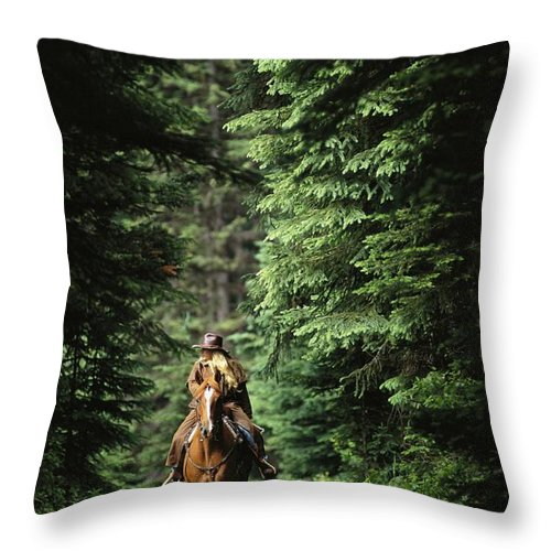 North America Throw Pillow featuring the photograph Horseback Riding On An Emerald Lake by Michael Melford