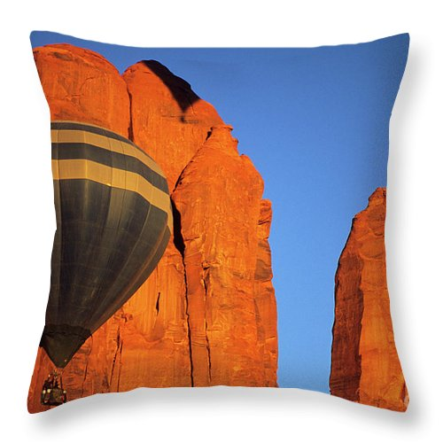 Hot Throw Pillow featuring the photograph Hot Air Balloon Monument Valley 1 by Bob Christopher