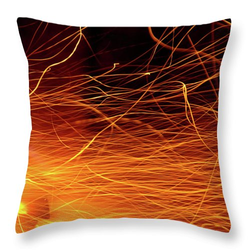Ablaze Throw Pillow featuring the photograph Hot Sparks by Carlos Caetano