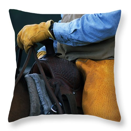 Cowboy Throw Pillow featuring the photograph In The Saddle Again by Bob Christopher