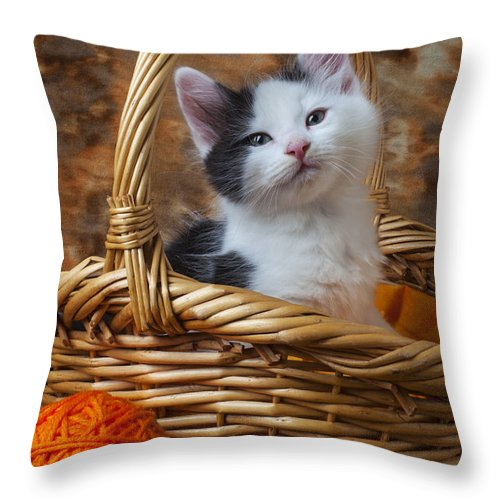 White Throw Pillow featuring the photograph Kitten In Basket With Orange Yarn by Garry Gay