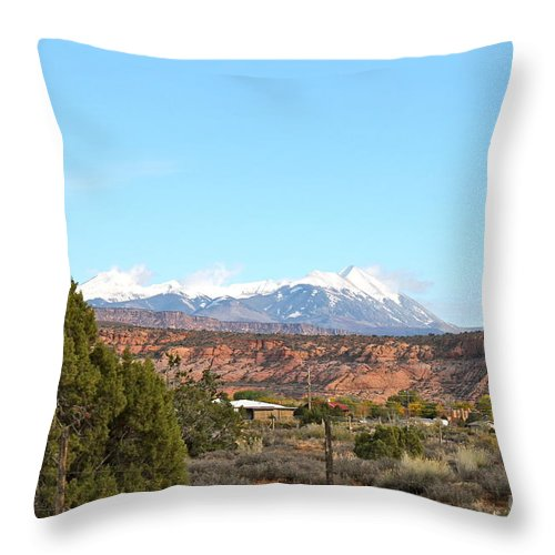 La Sal Throw Pillow featuring the photograph La Sal Mountains by Pamela Walrath