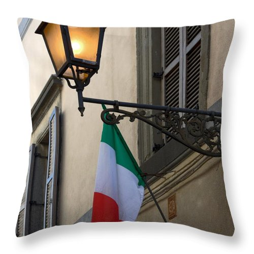 Lighted Anique Wall Light Throw Pillow featuring the photograph Lamp And Flag by Sally Weigand