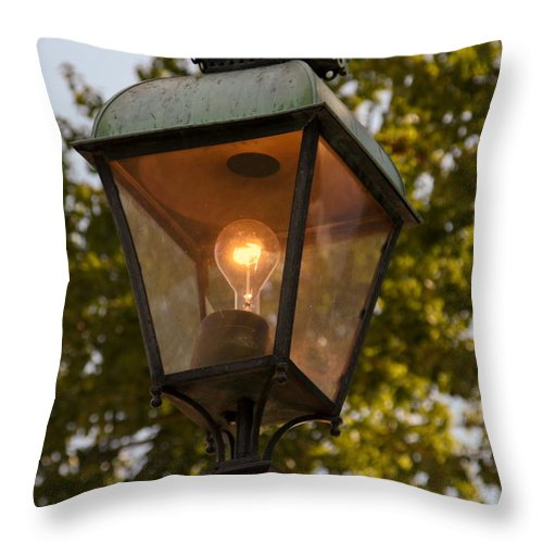 Lighted Street Lamppost Throw Pillow featuring the photograph Lighted Street Lamppost by Sally Weigand