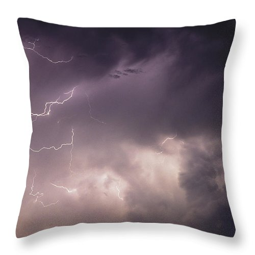 Natural Forces And Phenomena Throw Pillow featuring the photograph Lightning Flashes Over A Stand Of Trees by Stephen Alvarez