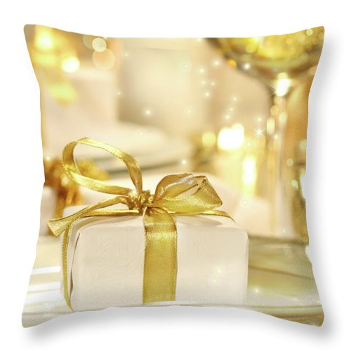 Banquet Throw Pillow featuring the photograph Little Gold Ribboned Gift by Sandra Cunningham