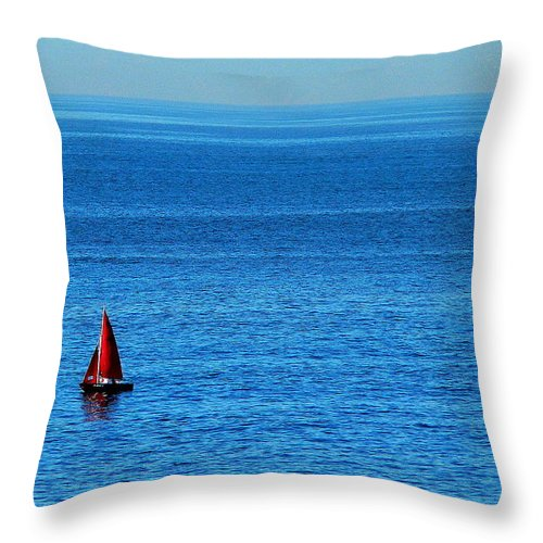 Red Sailboat Throw Pillow featuring the photograph Little Red Sailboat Giant Blue Sea by Jeff Lowe