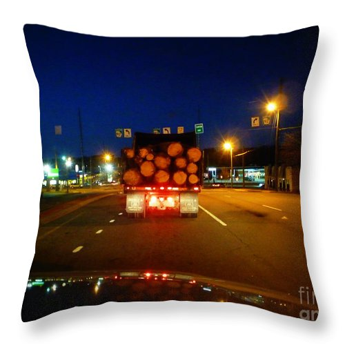 Log Throw Pillow featuring the photograph Logging Truck Ahead by Renee Trenholm