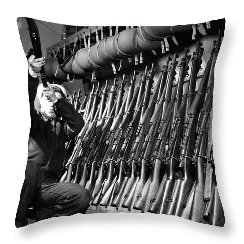 Vertical Throw Pillow featuring the photograph Looking Over Guns In Guard Room by Stocktrek Images