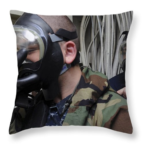 Warship Throw Pillow featuring the photograph Machinist's Mate Helps Another Sailor by Stocktrek Images