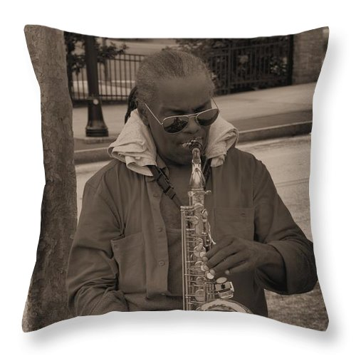 Man Throw Pillow featuring the photograph Man Playing His Saxophone by Donna Brown