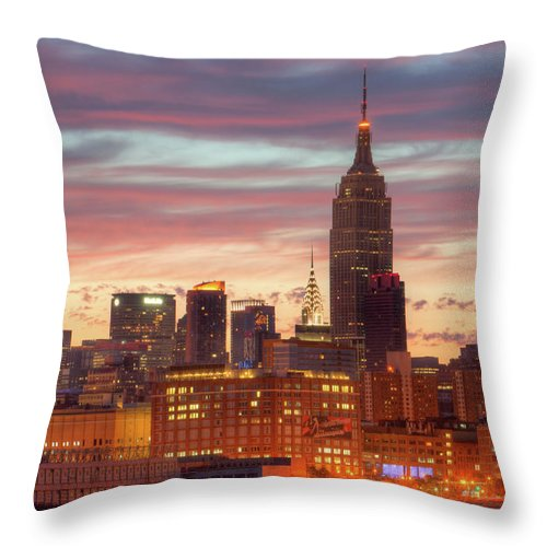Clarence Holmes Throw Pillow featuring the photograph Manhattan Buildings And Pre-sunrise Sky by Clarence Holmes