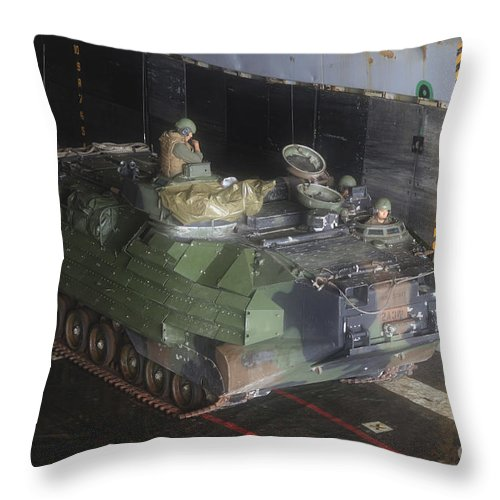 Warship Throw Pillow featuring the photograph Marines Wait To Launch Their Amphibious by Stocktrek Images