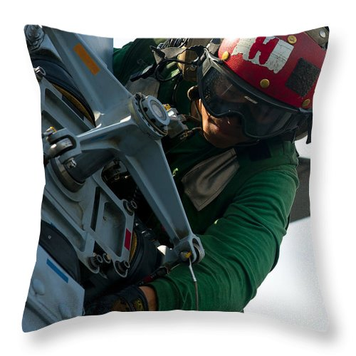 Safety Glasses Throw Pillow featuring the photograph Mechanic Inspects An Mh-60r Sea Hawk by Stocktrek Images