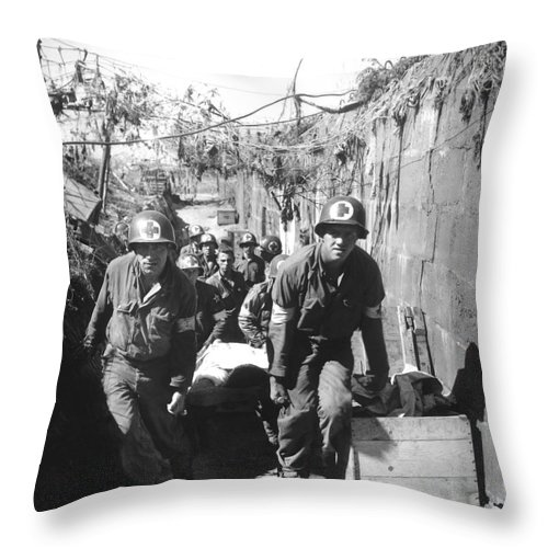 Vertical Throw Pillow featuring the photograph Medics Remove A Casualty by Stocktrek Images