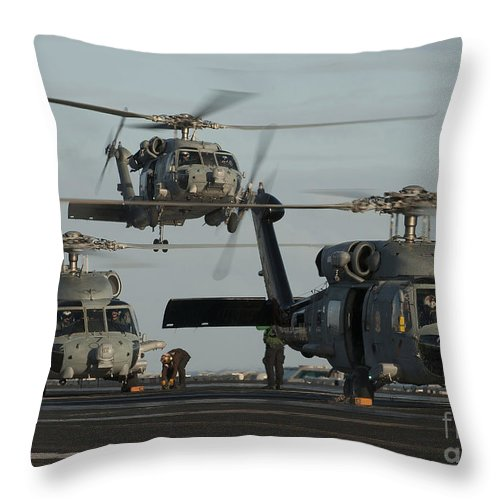 Warship Throw Pillow featuring the photograph Military Helicopters Land On The Flight by Stocktrek Images