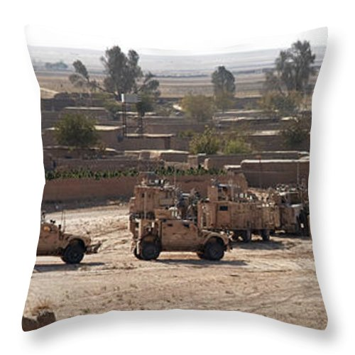Operation Enduring Freedom Throw Pillow featuring the photograph Military Vehicles Parked Outside Loy by Stocktrek Images