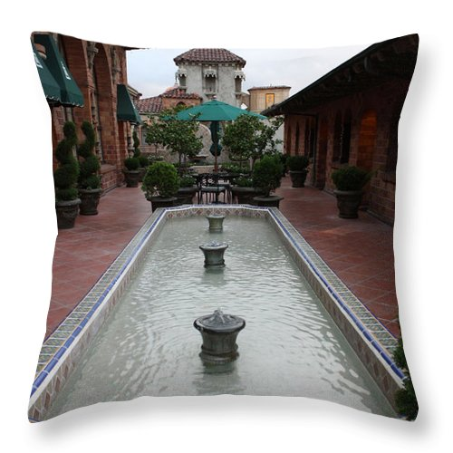 Mission Inn Throw Pillow featuring the photograph Mission Inn Roof Top Pond by Tommy Anderson