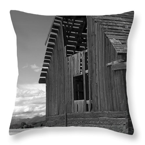 Sandra Bronstein Throw Pillow featuring the photograph Montana Weathered Barn by Sandra Bronstein