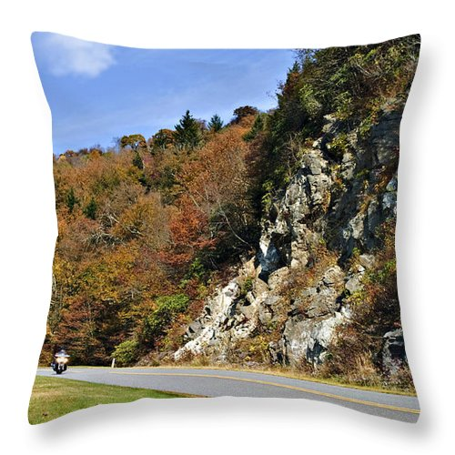 Highway Throw Pillow featuring the photograph Motorcycle On The Highway by Susan Leggett