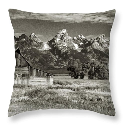Black & White Throw Pillow featuring the photograph Moulton Barn And The Grand Tetons by Sandra Bronstein