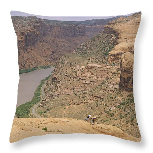 Cycles And Cycling Throw Pillow featuring the photograph Mountain Bikers On Slickrock Trail by Rich Reid