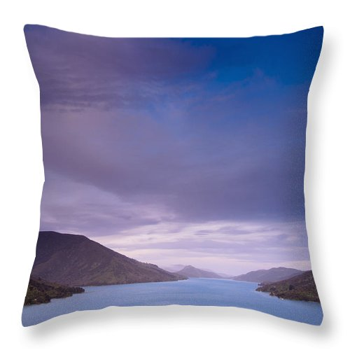 Blue Sky Throw Pillow featuring the photograph Mountains Along The Coastline Under A by David DuChemin