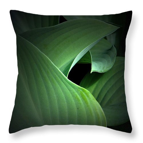 Mysterious Throw Pillow featuring the photograph Mysterious Hostas by Mike Nellums