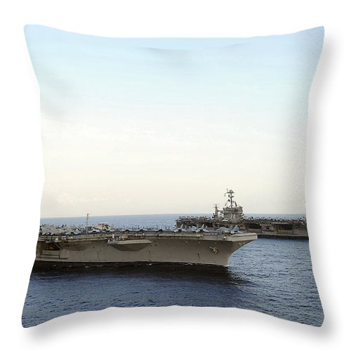 On The Move Throw Pillow featuring the photograph Nimitz-class Aircraft Carriers Transit by Stocktrek Images