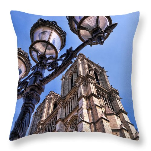 Notre Dame Cathedral Throw Pillow featuring the photograph Notre Dame Tower by Jon Berghoff
