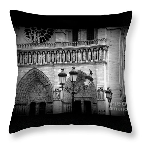 Notre Dame Throw Pillow featuring the photograph Notre Dame With Luminaires by Carol Groenen