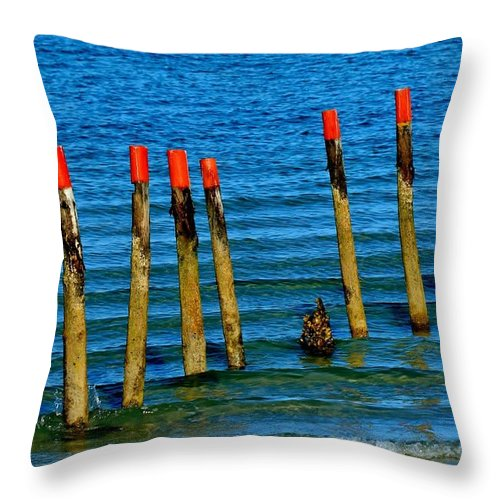Eleven; Red; Top; Wooden; Poles; Standing; Atlantic Ocean; Water; Sea; Seascape; Waves; Blue; Brown; Background; Shore; Throw Pillow featuring the photograph Ocean Eleven by Werner Lehmann