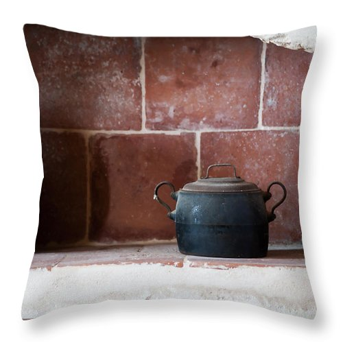 Scene Throw Pillow featuring the photograph old kitchen - A part of a traditional kitchen with a vintage metal pot by Pedro Cardona Llambias