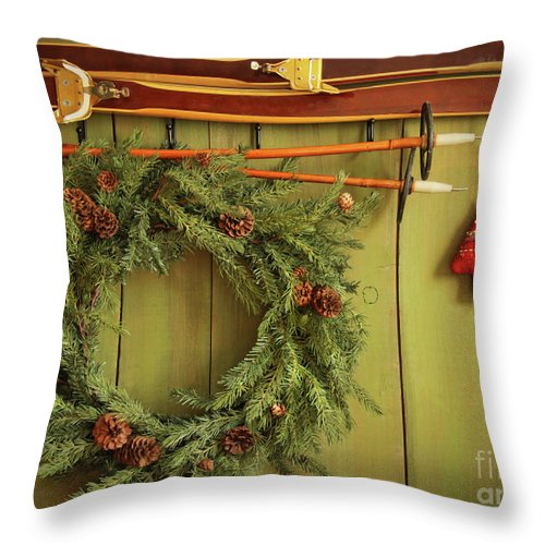 Antique Throw Pillow featuring the photograph Old Pair Of Skis Hanging With Wreath by Sandra Cunningham