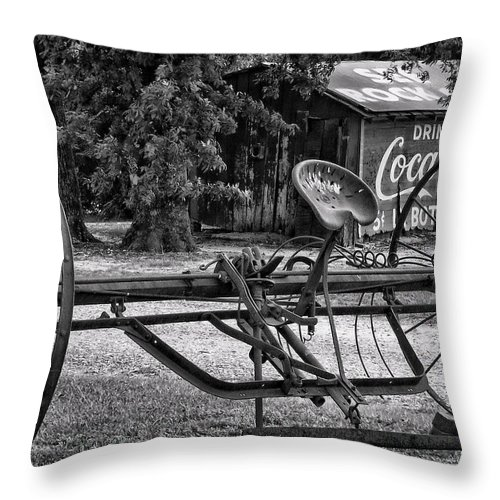 Black & White Throw Pillow featuring the photograph Old Plow by Susan Cliett