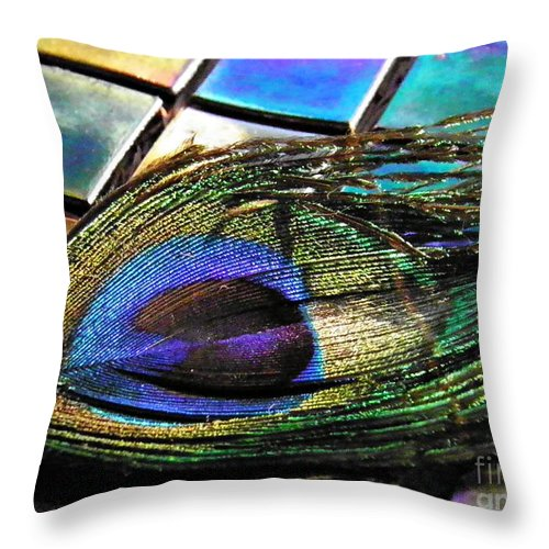 Feather Throw Pillow featuring the photograph Peacock Feather On Tiles by Sarah Loft
