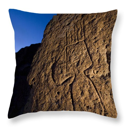 Petroglyphs Throw Pillow featuring the photograph Petroglyphs Are Seen At Twilight by Ralph Lee Hopkins