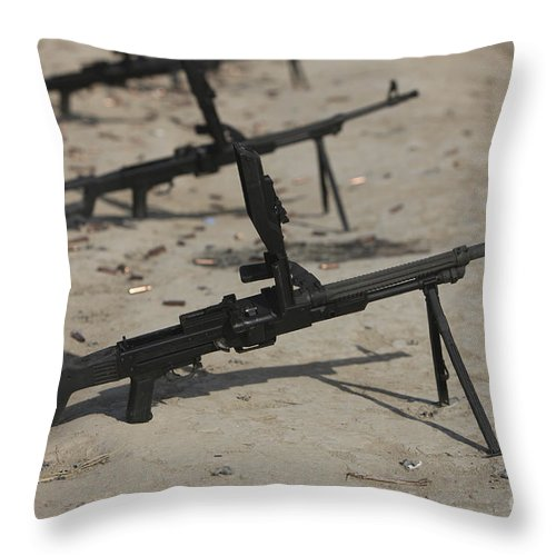 Bullet Throw Pillow featuring the photograph Pk General-purpose Machine Guns Stand by Terry Moore
