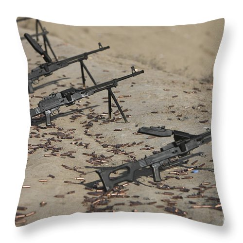 Kunduz Throw Pillow featuring the photograph Pk Machine Guns And Spent Cartridges by Terry Moore