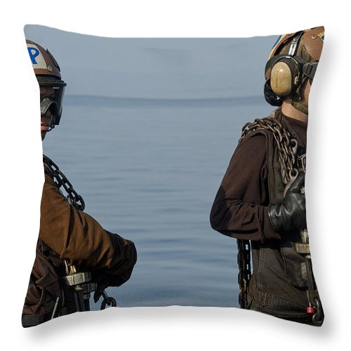 Warship Throw Pillow featuring the photograph Plane Captains Stand By During Aircraft by Stocktrek Images