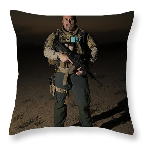 Rifle Throw Pillow featuring the photograph Portrait Of A U.s. Contractor by Terry Moore